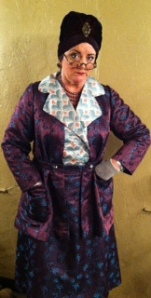 Madame Arcati as portrayed by Laurie Birmingham